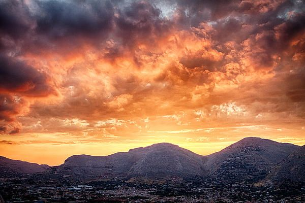 Dramatic sunset clouds over Mondello mountains, Italy.