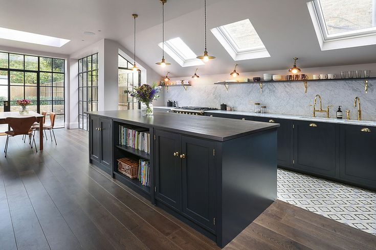 Stunning kitchen with dark cabinets, brass hardware, brass taps, marble and bert and may floor tiles. By 202 design, photographed by Alex Maguire