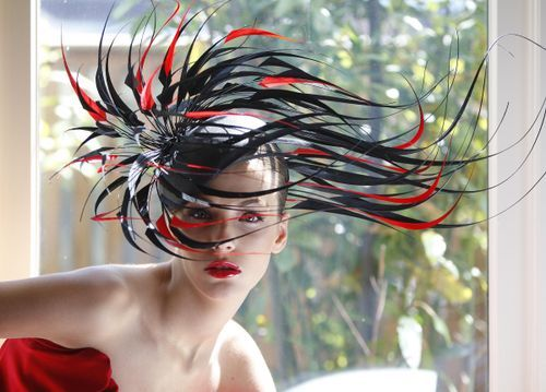 Seen here is a design by Philip Treacy who works regularly with Lady Gaga and also custom made a hat for her Fame Fragrance promotional poster
