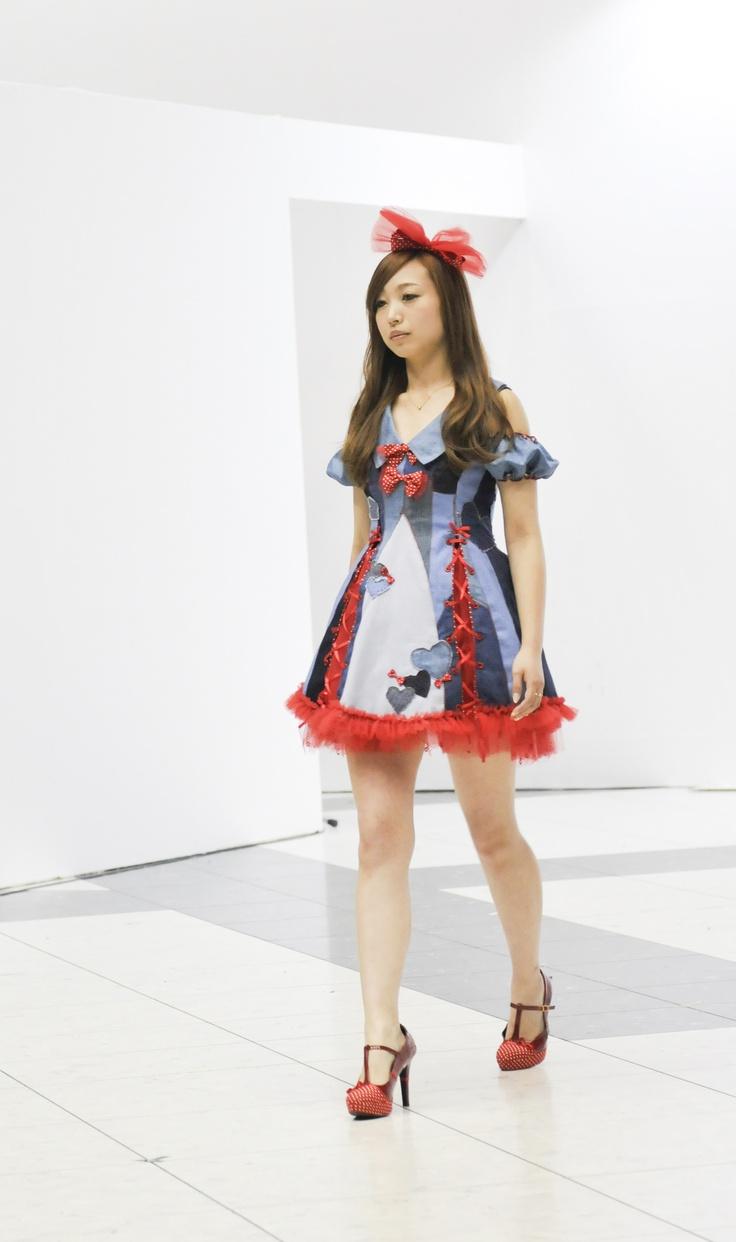 Beautifully original red and denim dress. 美しくて、ユニークな赤やデニムワンピース。 Mejiro Fashion and Art College. 目白ファションアンドアートカレッジのロリータっぽいファッションショー。 Tokyo, Japan.