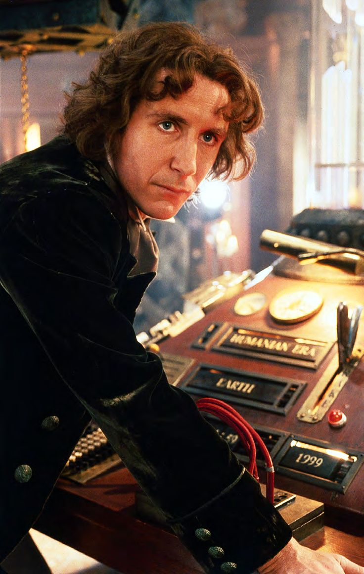 The Eighth Doctor with the TARDIS console.