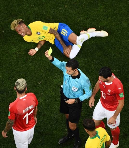 Referee Cesar Ramos Shows A Yellow Card To Switzerland S Midfielder Valon Behrami After A Tackle On Brazil S Forward Neymar Du Neymar Soccer Referee Midfielder