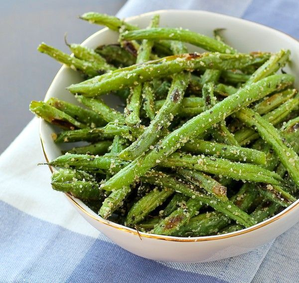 These roasted green beans with parmesan and basil are crispy, flavorful and probably don't even require a trip to the store -- just open your pantry and fridge! I don't know if I've ever seen my mom enjoy a food as much as she enjoyed these roasted green beans! Okay that might be an exaggeration, but my mom LOVED these little suckers. I had cranked out a bunch of recipes the day before she visited last time and I got these out with dinner the night she and my dad arrived. They wer...