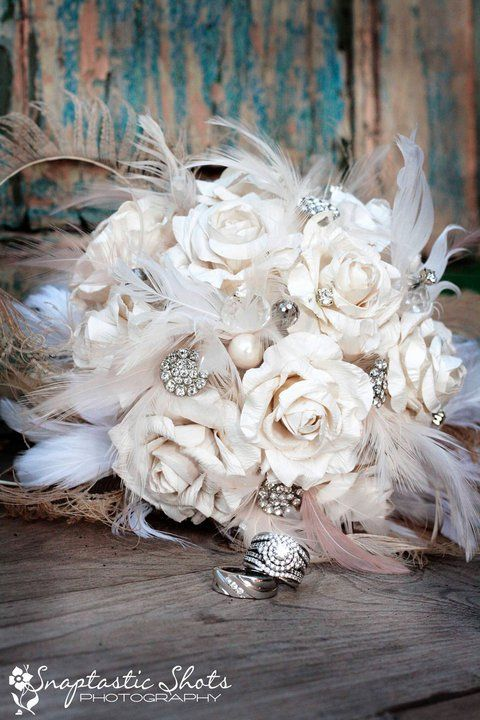 texasweddingsunveiled.blogspot.com Roses made from Paper with feathers and brooches... good idea for bouquet to toss