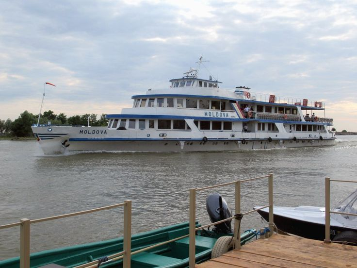 The classical passenger ferry Moldova cruises past Crisan on the Sulina navigation channel in the Danube Delta. Navrom ferries of this kind operate daily between Tulcea and Sulina, Romania.