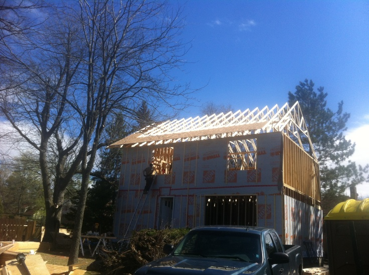 Trusses are up for the original section. We still need to sheet and build the garage addition.