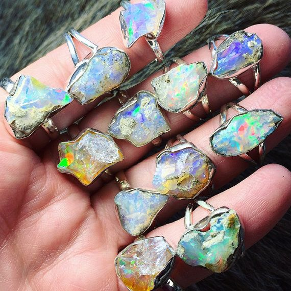 BIG raw opal ring | Chunky opal ring | Rough opal ring | Opal birthstone ring | Fire opal ring | Boho ring  ● one larger 14-17mm chunk of raw fire opal captured in a shiny sterling silver multiple prong setting. organic fire in each of the stones implemented ● shiny solid sterling silver band ● sizes range from 7-9, please select your desired size during checkout. ● rings pictured are those selected  ● ring will arrive carefully packaged ready for gift giving ● images taken in natural indoor…