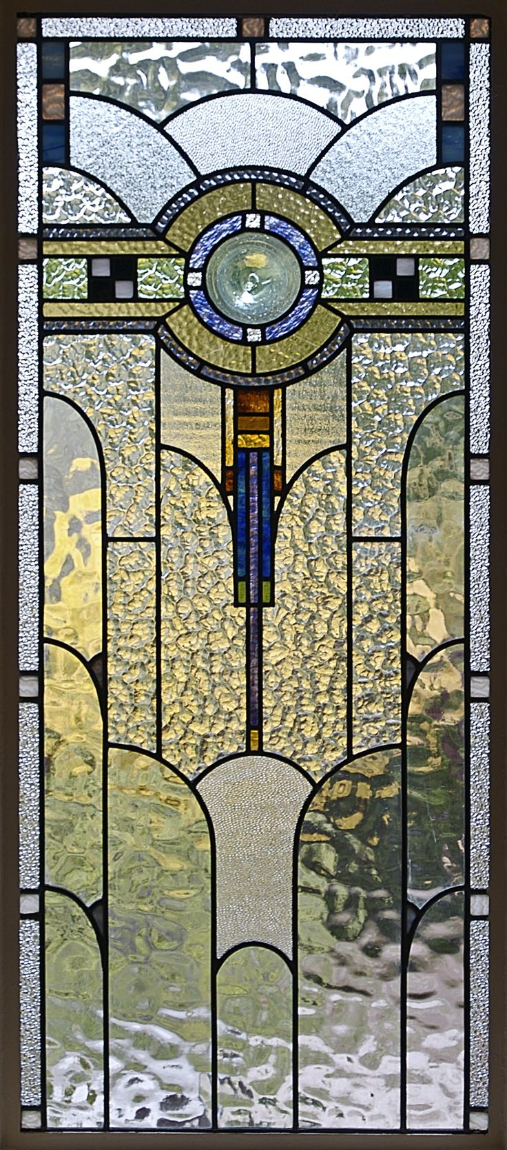 ❤ - An Art Deco domestic casement window, Melbourne, Australia, shows a wide variety of textured glass with some streaky glass in muted colours.