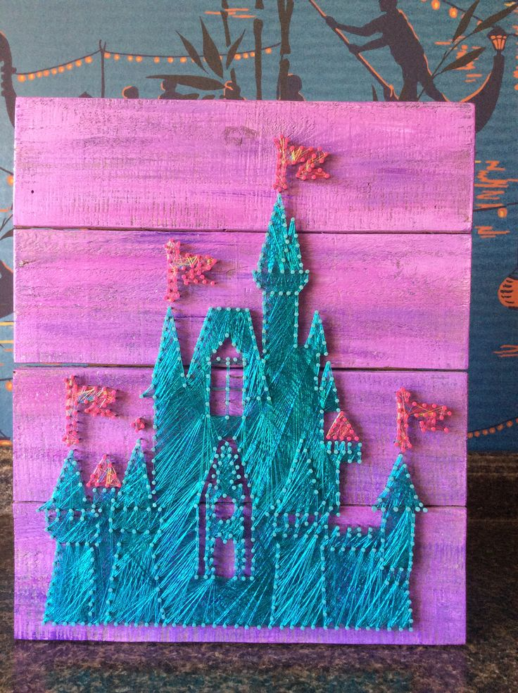 Not sure if it's painted underneath or really dense string. Pretty! Disney Castle by BrennanAthan