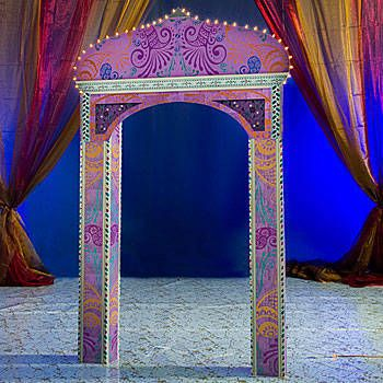 The Taj Mahal Arch features a pink, purple and orange paisley design with lights outlining the Taj Mahal inspired top.