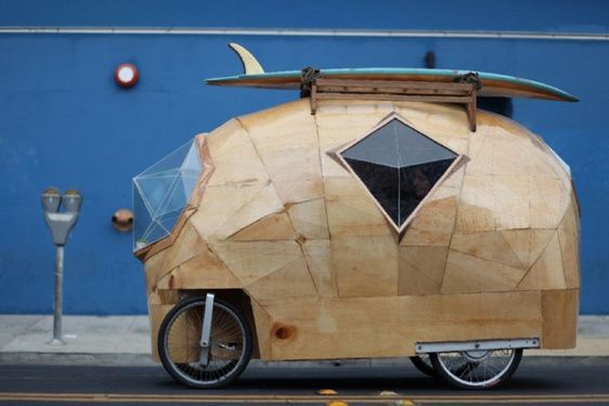 what? Is this for real? Apparently it is!! Designed by SF-based artist Jay Nelson, the Golden Gate is a modern electric camper car made with fiberglass, epoxy resin, plywood, glass, bike parts, and an electric motor. Comes with a kitchen, stove, cooler, storage cubbies, toilet, bed, and storage below the bed. And get this—the driver sits cross-legged while operating the vehicle.