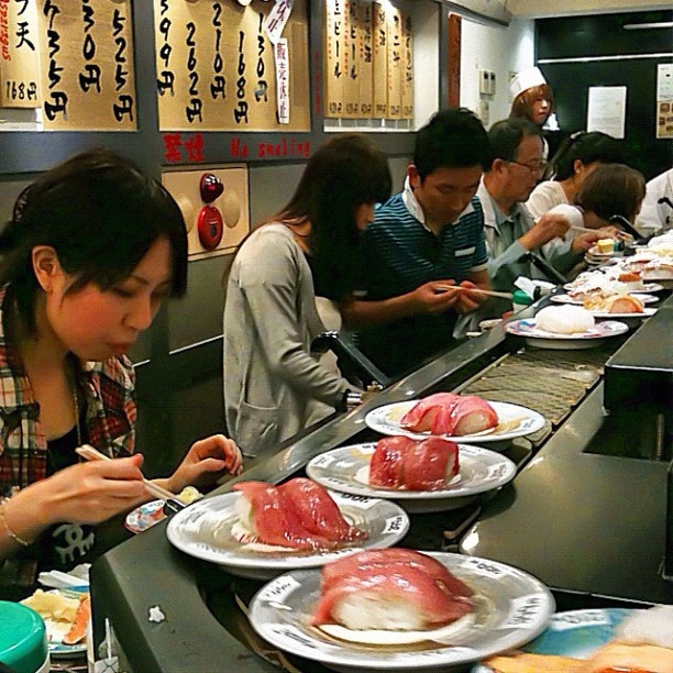 All aboard the sushi train! Sushi boats plus a 45-item a la carte sushi menu at just over a dollar per-plate = gorge in Tokyo.