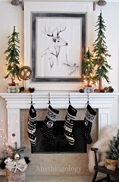 Christmas mantel with black and white stockings and trees
