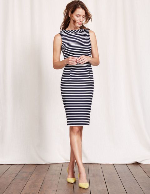 By popular demand, this bestselling favourite is back – a beautifully flattering sleeveless dress with an above-the-knee cut and tailored pleats at the waist to create an hourglass silhouette. We've finished off the structured style with a roll-collar for a modern take on femininity.