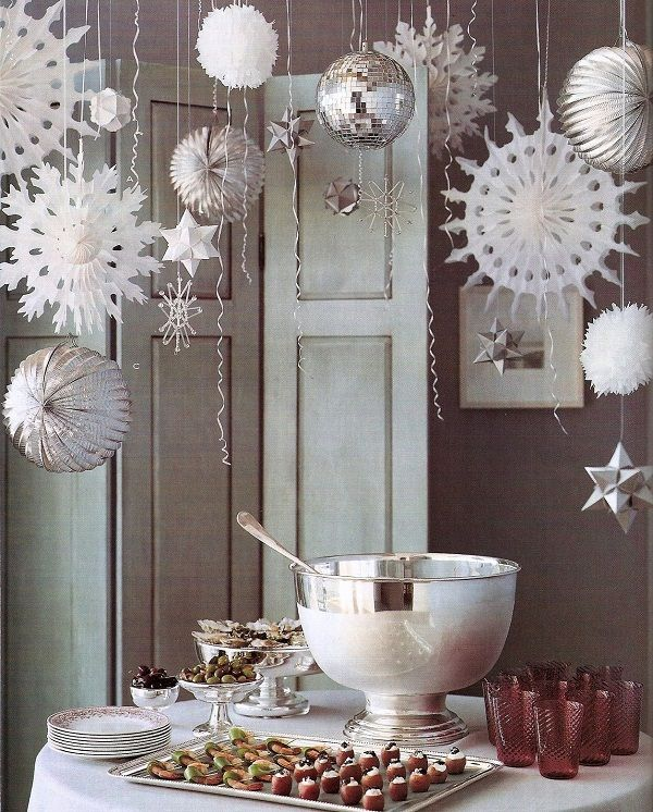 Snowflakes and pom poms in the corridor leading to the bathrooms, with splashes of gold