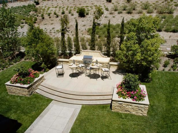 Barbecue Patio Landscaping: This Backyard Features A Raised Patio With A  Barbecue Grill. From