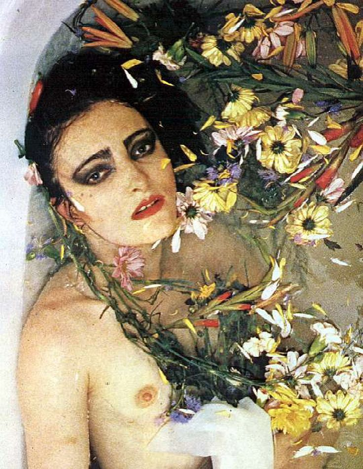 Siouxie Sioux in a bath of petals