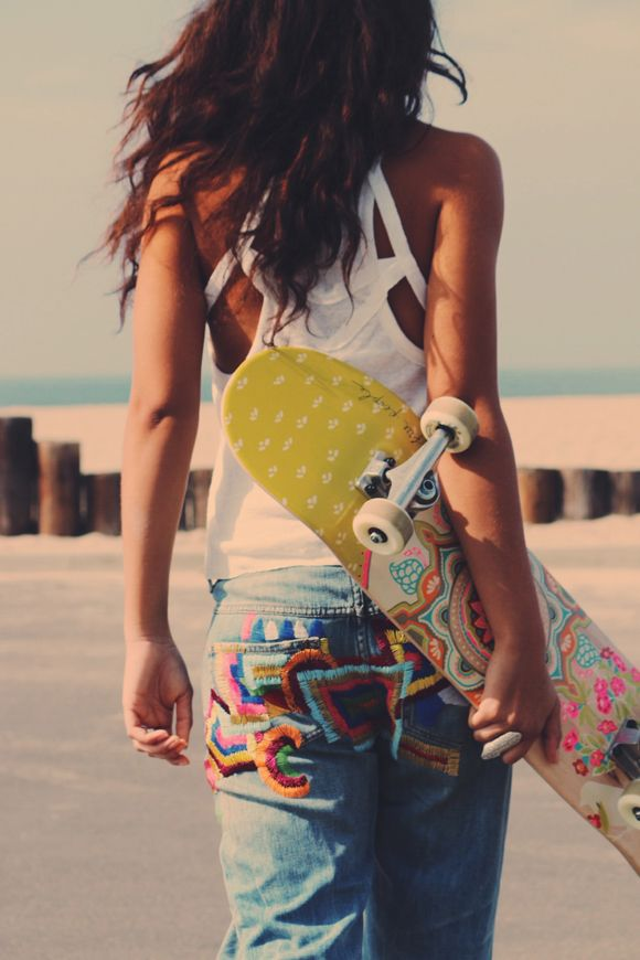 These bright embroidered jeans and cool cut out tank from free people are great for a laid back festival look.
