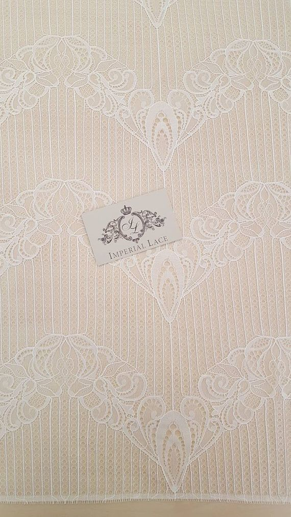 Off white lace fabric, French Lace, Embroidered lace, Wedding Lace, Bridal lace, off white Lace, Veil lace, Lingerie Lace Chantilly Lace  Article: B00198 Width: 140 cm(55 inches), listed for one meter (100 cm x 140 cm). Colors: off white Style: French Lace edge: Both sides scalloped  Sold per meters (100cm x 140 cm)   Symmetrical embroidery floral pattern, with lovely flowers.  Very soft and romantic. Perfect for dress, tops, skirts and other clothing. Very stunning and elegant!  IMPORTANT…