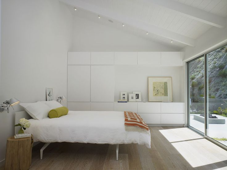 White-oak flooring and custom millwork in bedroom of Los Angeles renovation by Montalba Architects.