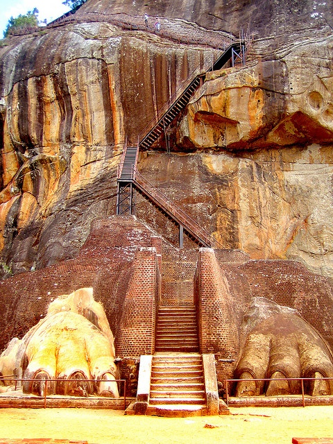 Sigiriya, Sri Lanka. On a small plateau about halfway up the side of this rock he built a gateway in the form of an enormous lion. The name of this place is derived from this structure —Sīhāgiri, the Lion Rock. The capital and the royal palace were abandoned after the king's death. It was used as a Buddhist monastery until 14th century