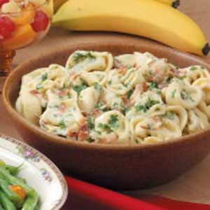 Creamy Tortellini Carbonara | Taste of Home   •1 package (9 ounces) refrigerated cheese tortellini  •8 bacon strips, cooked and crumbled  •1 cup heavy whipping cream  •1/2 cup minced fresh parsley  •1/2 cup grated Parmesan cheese