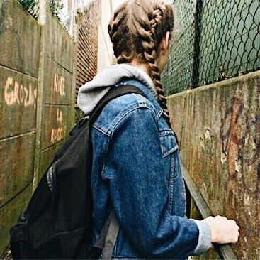 90s grunge style aesthetic ~ french braid pigtails ~ blue jean jacket ~ gray hoodie ~ black backpack