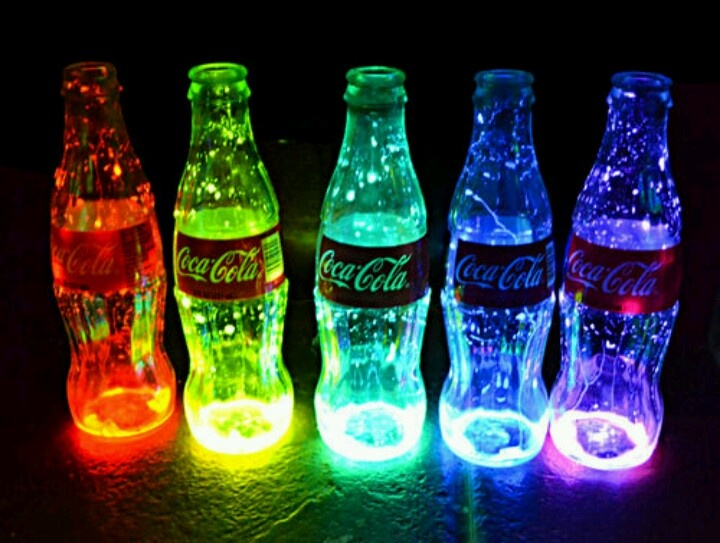 Coca Cola lights Buy some colored glow sticks and put them in the bottom of Coca Cola glasses