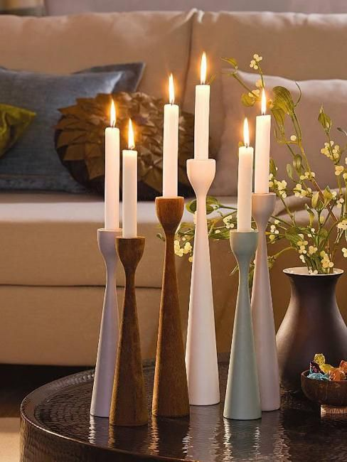Tall ivory candles create a warm glow standing in their sleek & contemporary candleholders!