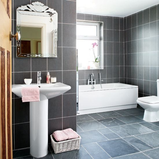 Bathroom Inspiration. I love the grey tile walls, it would be too much in our little space, but perhaps around the tub and on the floor? With a different grey wall? then the white of the shower, sink, toilet and I could get 4 sets of hand towels depending on the season and swap out with a rug for a new look.