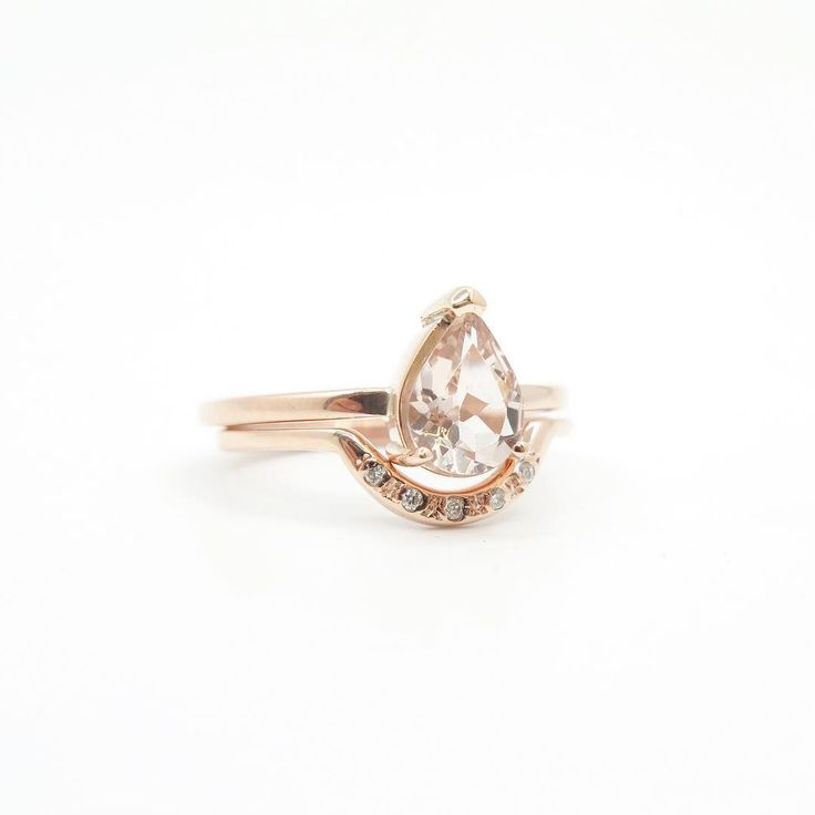 A beautiful claw set teardrop Morganite ring paired with a white diamond arch band.  #DearRae #DearRaeJewellery #MorganiteEngagementRing #MorganiteTeardropRing