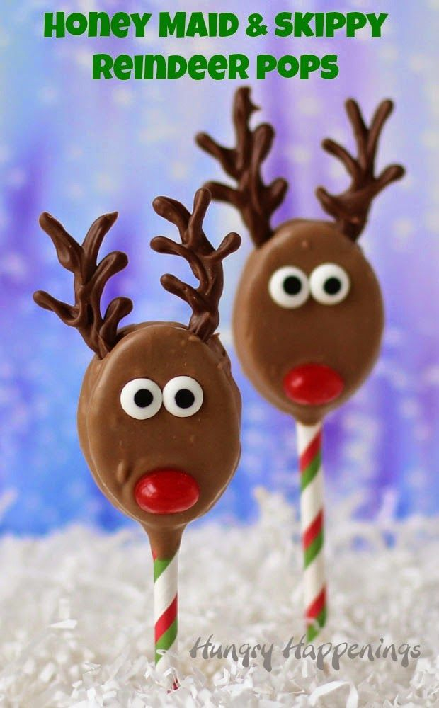 Reindeer Pops  form HungryHappenings.com Chocolate and peanut butter fudge dipped graham cracker sandwiches decorated like Rudolph.