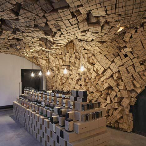 Melbourne practice March Studio have trapped 4500 cardboard boxes behind netting in this store for Australian skincare brand Aesop | new store at Merci in Paris