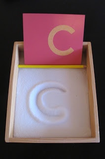 Salt Tray Letter Leaning - This Montessori-style activity let's your little one lean how to mimic what a letter looks like, along with the opportunity to ask them what a certain word starts with, so they can draw that letter in the salt tray. Post courtesy of @JenMontessori