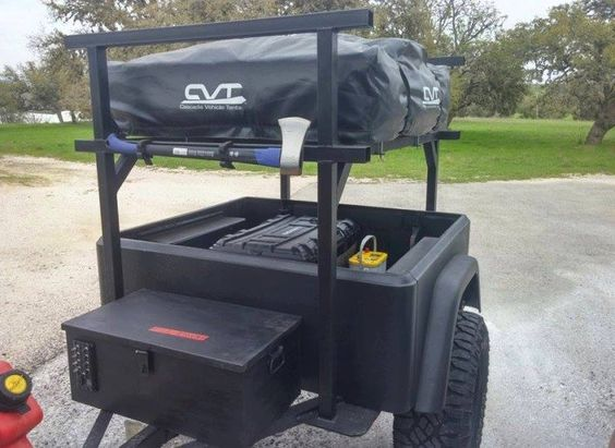 This Dinoot customers home-built welded rack is a good example of what you could do for many trailer styles with our new No Weld Trailer Rack System. As shown, you can easily access your gear under the tent and haul kayaks above your roof top tent. Could also add bars just above the tub height for hauling your kayaks under the tent.
