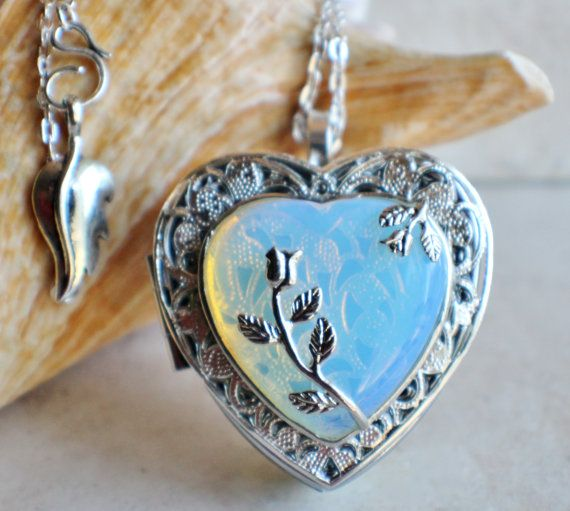 White opal quartz music box locket, heart shaped locket with music box inside, in silver tone with white opal quartz crystal heart.