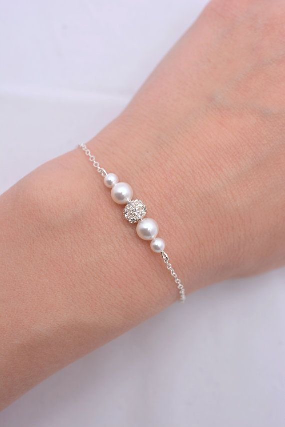 This beautiful minimalist bracelet is hand-crafted using quality sterling silver chain, Swarovski pearls and sparkling rhinestones. Available in