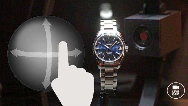 A touch screen enables you to explore James Bond's watch and discover all the secrets thanks to a controllable spy camera.    James Bond Time à l'Espace Horloger: Contrôler l'explorer avec l'écran tactile.  Un écran tactile vous permet d'explorer la montre de James Bond et d'en découvrir tous les secrets grâce à une caméra espion pilotable.