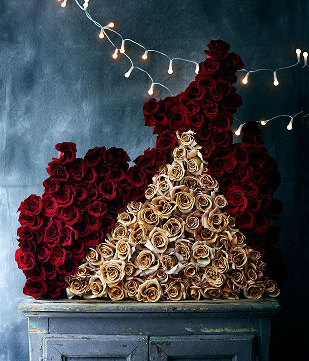 "Gourmet Traveller - ""I like the idea of architectural floral arrangements. This is my version of a gothic Christmas. There is a medieval sense of decadence and absurdity, particularly when using such a vast number of roses to celebrate this one day in the year. I'm Italian, though, so it figures."" Lisa Cooper, Doctor Cooper Studio"