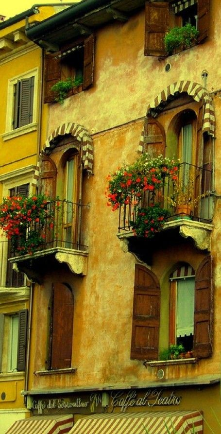 Renaissance balconies above the Caffe Al Teatro in Verona, Italy:
