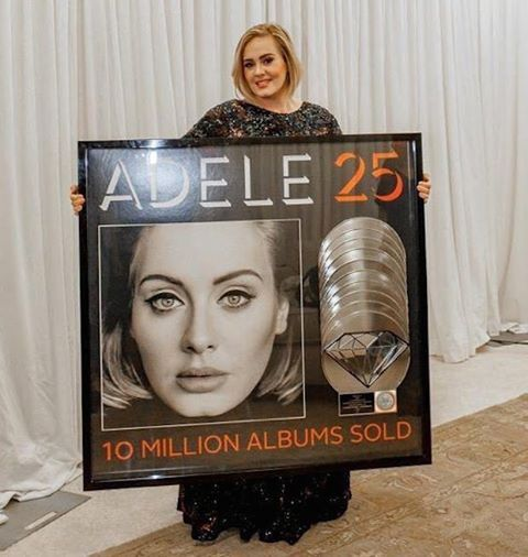 Photo by Myrna Suarez BTPR Adele poses with her Diamond Plaque presented by RIAA.