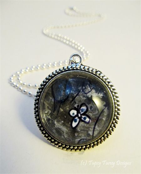 Mixed media art pendant in navy and grey hues with butterfly www.madeit.com.au/TupsyTurvy