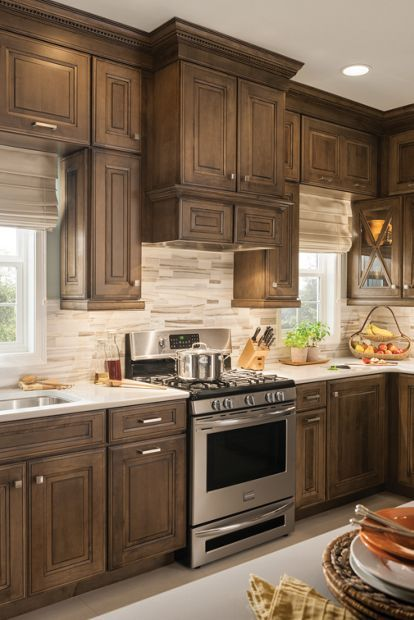 one piece hood with storage space and glaze finish schuler cabinetry maple cabinets