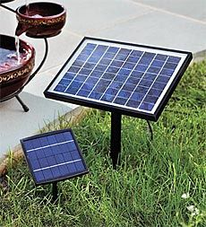 Solar-Powered Fountain Pumps With A/C Adaptor - might be easier to hide than an power cord!