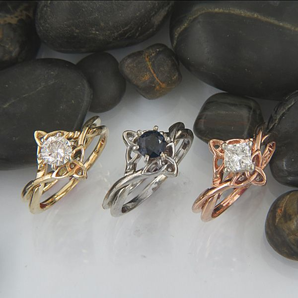A stunning grouping of Celtic interlocking trinity knot engagement rings with diamonds and sapphires.