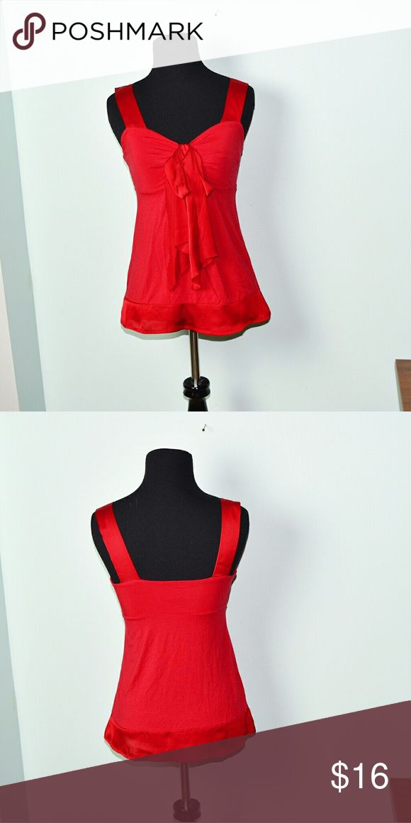Ann Taylor Red Bow Flowy Blouse In excellent condition! Very stretchy, beautiful, and flowy! Buy 3 items and get 1 free plus 15% off your purchase total! Ann Taylor Tops Blouses