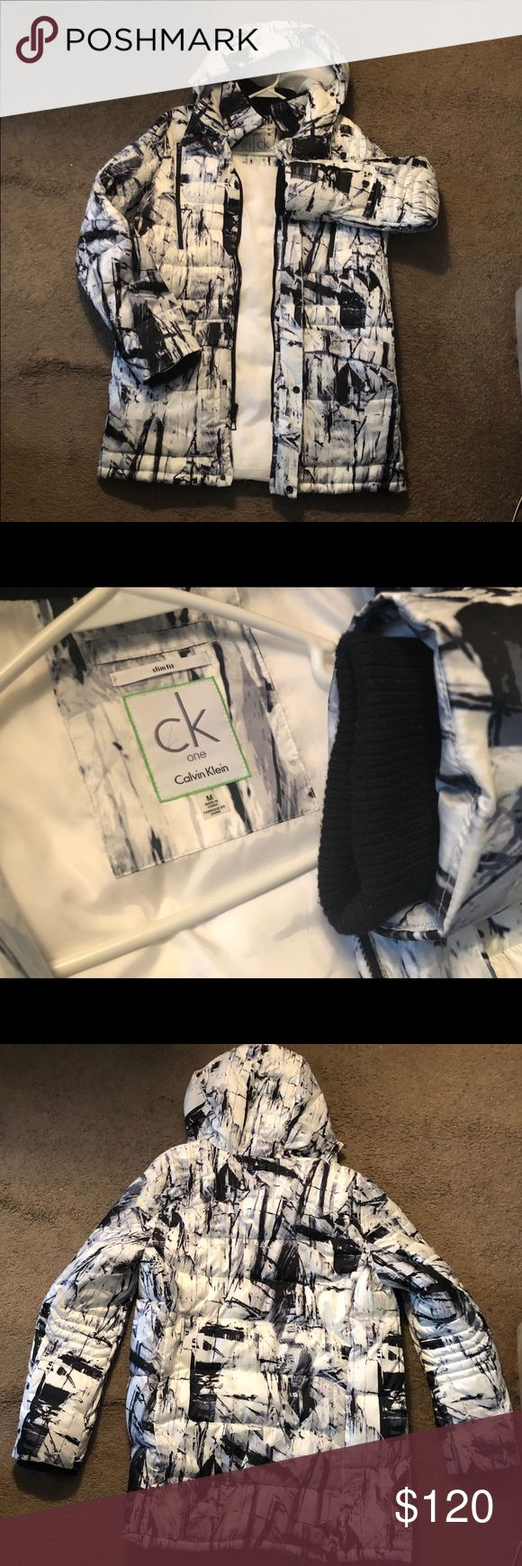 """Calvin Klein """"One"""" Edition Foil Graphic Coat You will not fine this piece in store many places, very unique design with 2 large pockets in the front followed by 2 zip up chest pockets , detachable  hoodie, 2 flaps to protect face from wind, bomber/hoodie like sleeves in the interior..very warm and stylish only worn once ! Pass as new Calvin Klein Jackets & Coats"""
