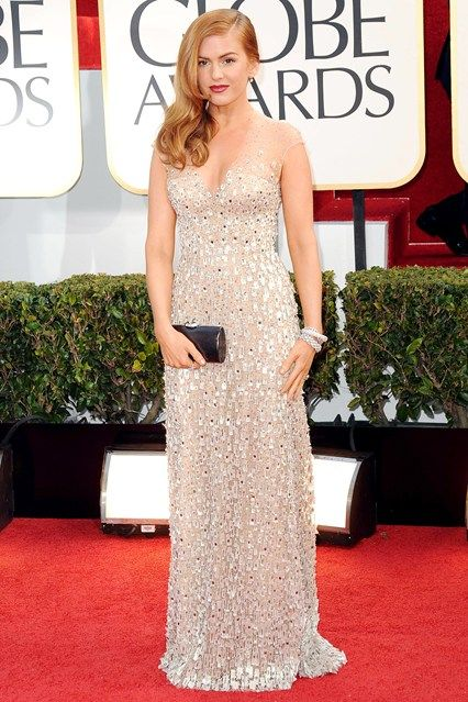 Isla Fisher wore a Reem Acra nude gown with all-over crystal embellishment.