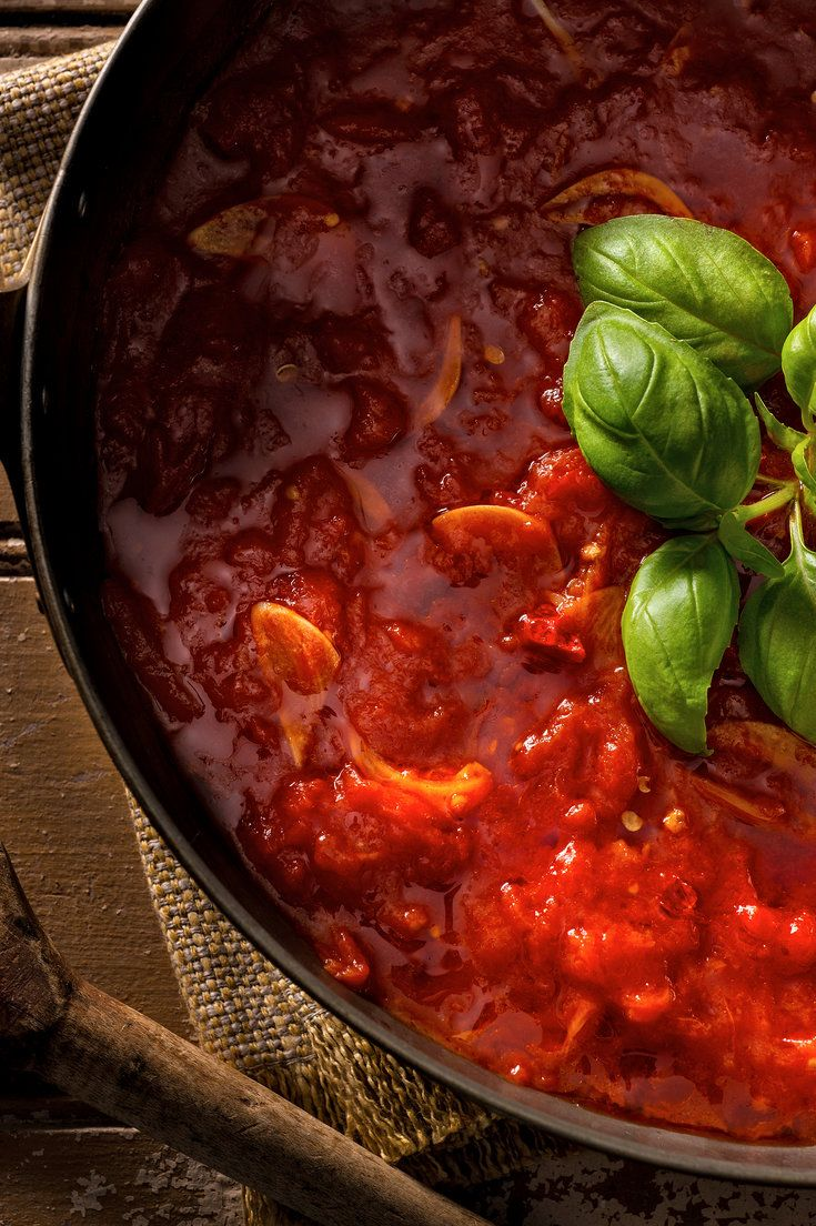 Homemade marinara is almost as fast and tastes immeasurably better than even the best supermarket sauce — and it's made with basic pantry ingredients. All the tricks to a bright red, lively-tasting sauce, made just as it is in the south of Italy (no butter, no onions) are in this recipe. Use a skillet instead of the usual saucepan: the water evaporates quickly, so the tomatoes are just cooked through as the sauce becomes thick. (Photo: Francesco Tonelli for NYT)