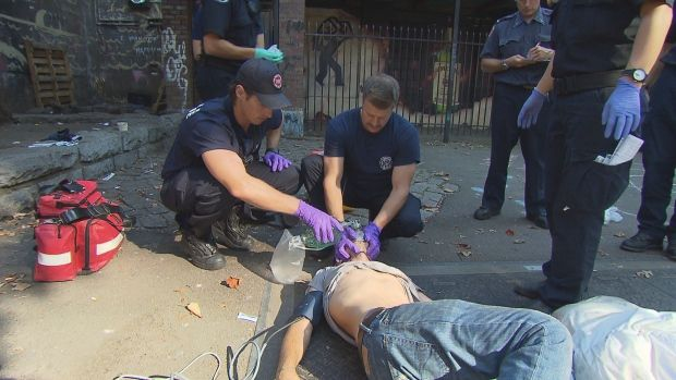 Vancouver firefighters Jason Lynch and Jay Jakubec try to revive an addict who has already had two doses of Narcan after overdosing on fentanyl in Vancouver's downtown eastside.